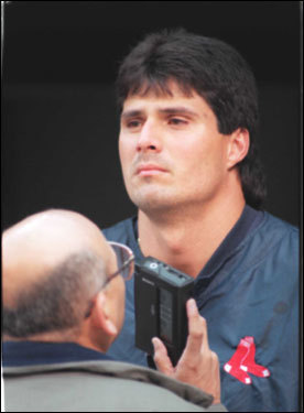 Jose Canseco of the Red Sox was interviewed before the start of Game 2 at Jacobs Field. Canseco went 0-for-13 for the series.