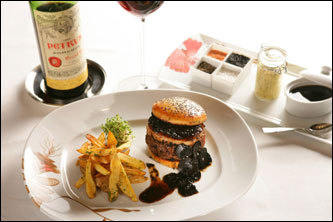 You can get a $5,000 Kobe hamburger with truffles and foie gras at Mandalay Bay's Fleur de Lys. The meal includes a bottle of 1995 Château Pétrus, which accounts for about $4,975 of the total price.