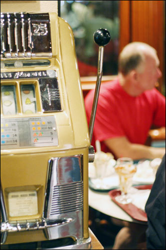 An old-time slot machine is part of the decor at the Golden Gate.