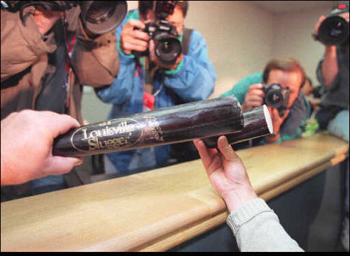 Photographers swarmed around the bat belonging to Albert Belle of the Indians that was cut and examined at request of Red Sox manager Kevin Kennedy after he homered in Game 1. The bat was ruled legal.