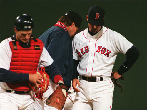 Tim Wakefield (right) gives up the ball to manager Kevin Kennedy in the sixth inning of Game 3. Wake's line: 5 1/3 innings pitched, seven runs, five hits, five walks, and four strikeouts.