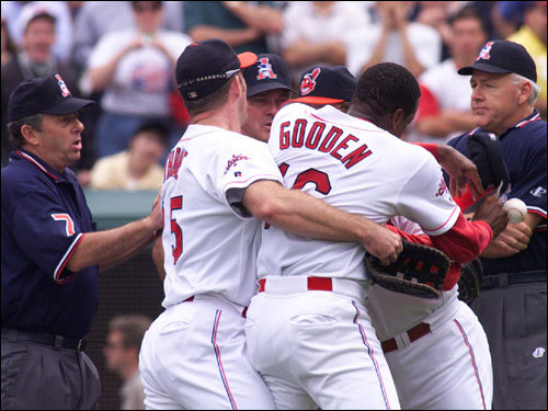 Indians pitcher Dwight Gooden was restrained after he tried to go after home plate umpire Joe Brinkman after Brinkman made a controversial safe call when the Sox' John Valentin slid into the plate in Game 2.