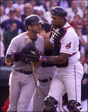 John Valentin was held back by Cleveland's Sandy Alomar as he threatened to charge the mound after being brushed back by Indians pitcher Mike Jackson in the ninth inning of Game 2.