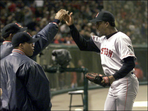 Pedro Martinez got a high five as he headed to the dugout in the seventh inning of Game 5 in Cleveland. Pedro pitched six innings of no-hit relief to help the Sox advance to the ALCS with a 12-8 come from behind win.