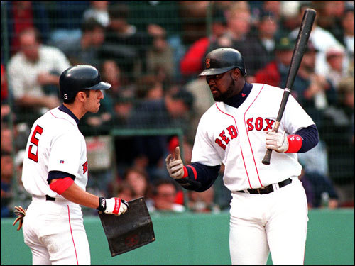 Mo Vaughn spoke with Nomar Garciaparra in the on-deck circle during Game 4 at Fenway Park.