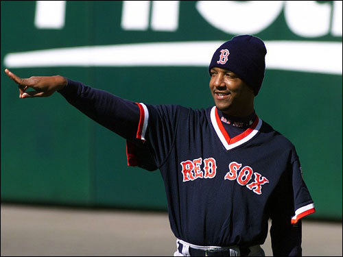 Red Sox Game 1 starting pitcher Pedro Martinez wore a stocking cap, even though it was not that cold, during Boston's afternoon workout in preparation for the '99 playoff series opener with the Indians in Cleveland.