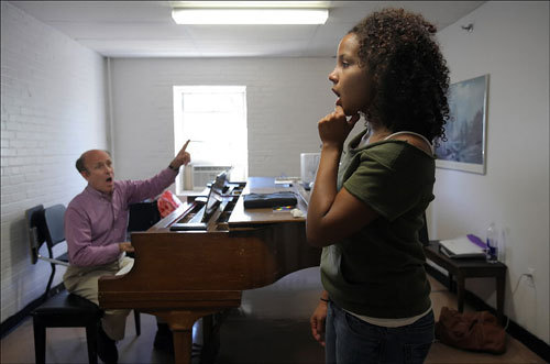 Voice instructor Merrill Shea (left) practiced notes with Boston Conservatory student Stephanie Umoh.