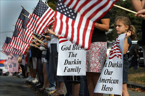 Several hundred people carried flags and lined the route of the funeral procession for Army National Guard Specialist Ciara Durkin at Saint John the Baptist Church.