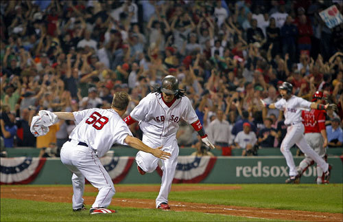 Manny Ramirez received a hand from Jonathan Papelbon as he ran up the first baseline following his game winning home run.