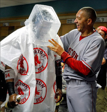 Red Sox designated hitter David Ortiz wore an ice bucket on his head courtesy of teammate Julian Tavarez as they celebrated in the clubhouse.