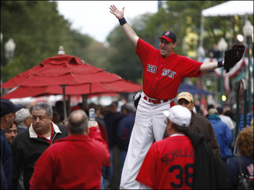 Fans walked on Yawkey Way before the game.
