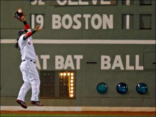 Manny Ramirez leaped to snag the third out of the second inning.