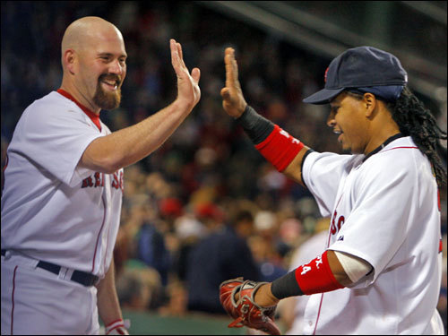 Kevin Youkilis (left) congratulated with Manny Ramirez (right) after Manny's spectacular catch.