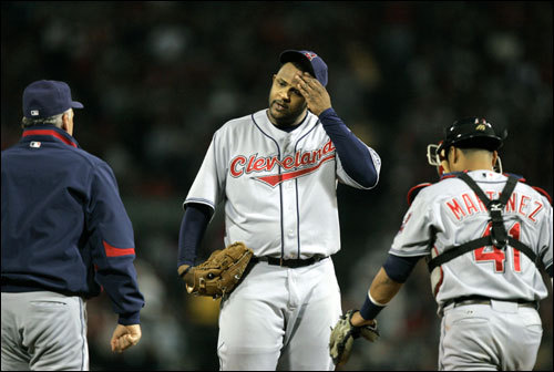 Indians pitcher C.C. Sabathia (center) got a visit from pitching coach Carl Willis (left), and catcher Victor Martinez (41) in the first inning.
