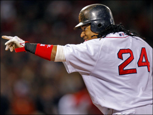 Manny Ramirez waved at teammates in the dugout after getting a hit in the first inning.