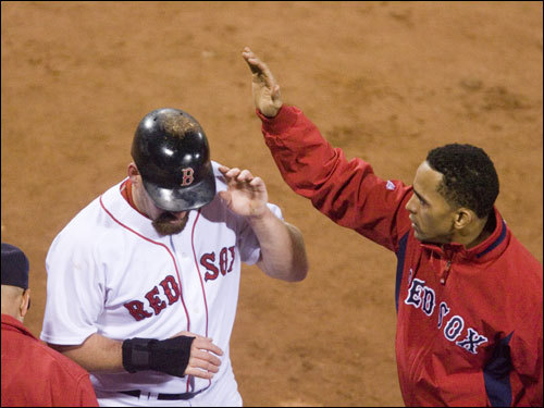 Red Sox first baseman Kevin Youkilis (left) was congratulated by Julio Lugo (right) in the sixth inning.