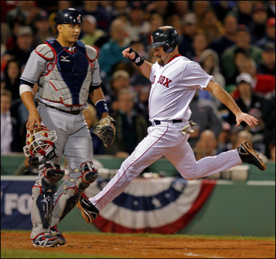 Kevin Youkilis crossed the plate as Indians catcher Victor Martinez looked on in the sixth inning.