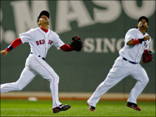 Sox shortstop Julio Lugo (left) and Manny Ramirez (right) followed a high fly ball in left field that fell in during the seventh inning.