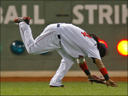 Manny rolled on the outfield grass after gloving the liner.