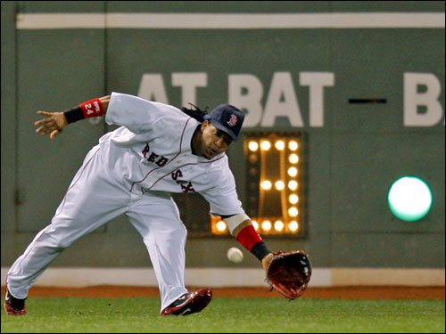 Manny Ramirez reached for a diving line drive in the seventh inning.