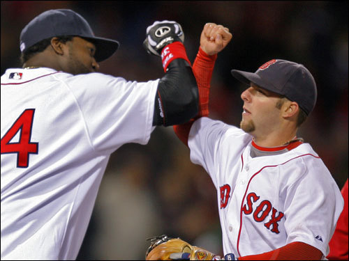 David Ortiz (left) and Dustin Pedroia (right) celebrated the Red Sox win in Game 1 of the ALCS.