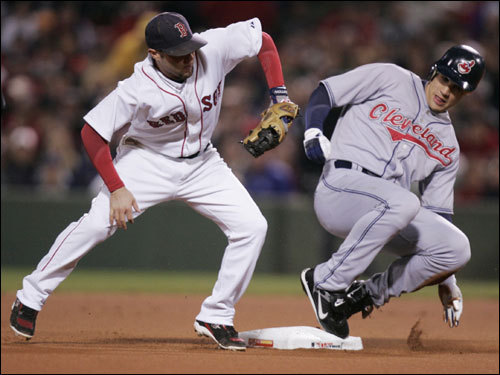 Grady Sizemore (right) slid into second base with a leadoff double.