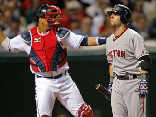 Sox second baseman Dustin Pedroia (right) reacted to striking out to start the game.