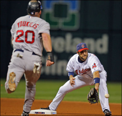 Red Sox first baseman Kevin Youkilis (20) was out at second base as Indians third baseman Casey Blake caught the ball and prepared to turn the doubleplay.