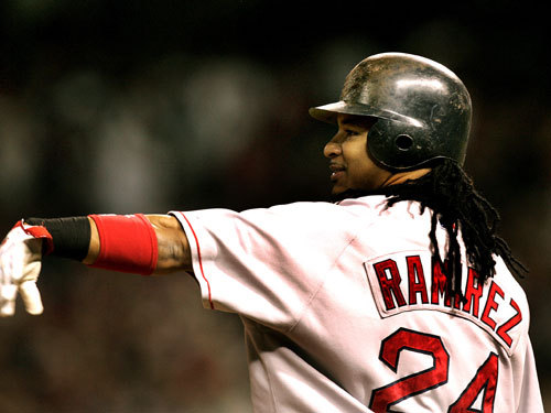 Manny Ramirez gestured to Kenny Lofton in left field during the second inning.