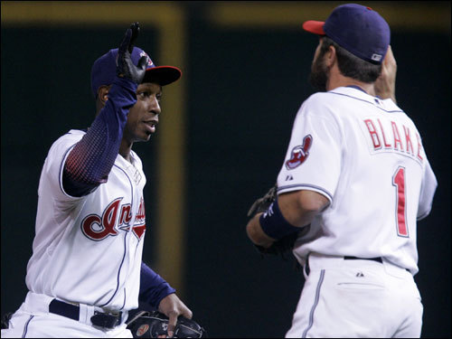 Kenny Lofton (left) and Casey Blake (right) celebrated the Indians 4-2 victory over the Red Sox in Game 3 of the ALCS.