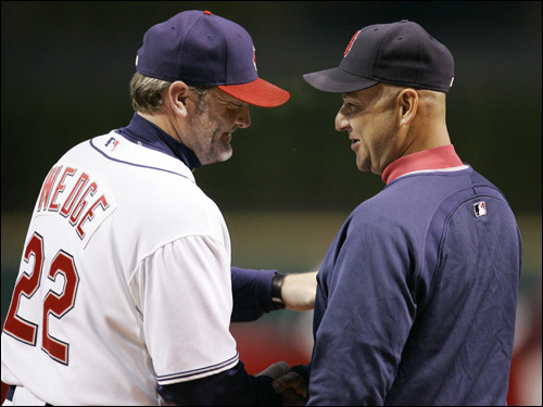 Managers Terry Francona, right, and Eric Wedge meet at home plate before the game.