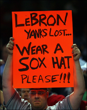 A Cleveland fan holds up a sign directed at Cavaliers star LeBron James.