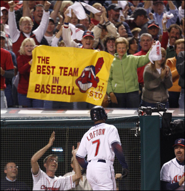 Cleveland fans cheer on Kenny Lofton (7) after he hit a home run.