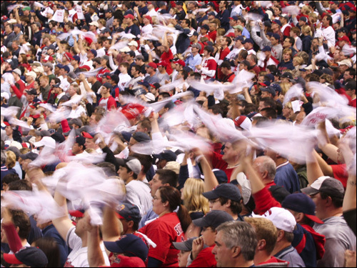 Cleveland fans swirl white towels during the game.