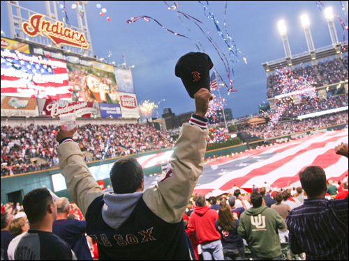 A member of Red Sox Nation cheers during the pregame festivities.