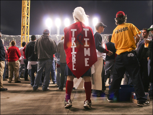 As the back of this fan's costumes declares, it was Tribe Time during Game 3.