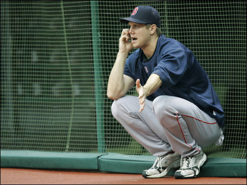 Jonathan Papelbon speaks on a cellphone prior to the start of Game 4.