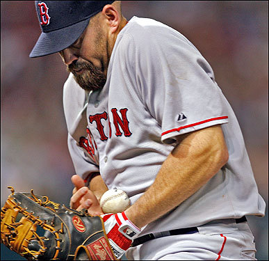 Red Sox first baseman Kevin Youkilis had the ball roll up his arm, but he made the play and retired the Grady Sizemore in the third.