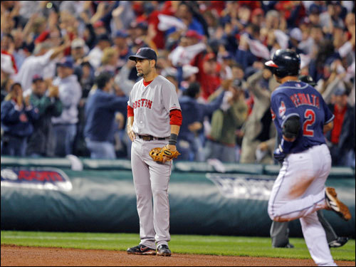 Jhonny Peralta rounded the bases after his fifth-inning, three-run home run off Manny Delcarmen sent the home crowd into a frenzy. Red Sox third baseman Mike Lowell didn't join the party.
