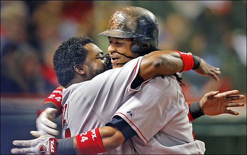 David Ortiz (left) greeted Ramirez with a hug just outside the dugout following Ramirez's sixth-inning solo home run. Ramirez followed Youkilis and Ortiz with the third straight home run for the Red Sox that inning.
