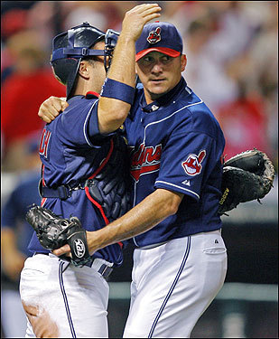 Two former members of the Red Sox organization, Shoppach and pitcher Rafael Betancourt (right) celebrate after the final out of the Indians' victory.