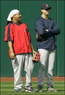 Boston Red Sox left fielder Manny Ramirez (left) laughs with Beckett during practice.