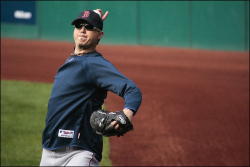 Josh Beckett threw a couple of pitches in the outfield during an optional practice at Jacobs Field on Wednesday afternoon.