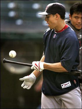Red Sox rookie outfielder Jacoby Ellsbury plays around with a bat and ball while waiting to take batting practice Wednesday.