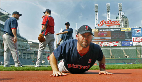 The Indians have the Red Sox down on the mat, but captain Jason Varitek and his teammates hope to get up and back into the series in Game Five with Josh Beckett on the mound. Varitek is seen as he stretches prior to practice.