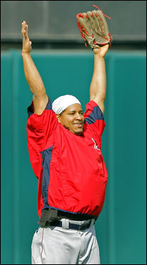 He isn't really recreating his home run pose from Game Four; Manny Ramirez is signalling 'it's good' after he hit his target while throwing balls in from left field while shagging during batting practice.