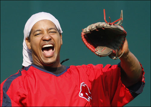 Manny Ramirez laughs during Boston's workout in preparation for Game 5 of the ALCS.
