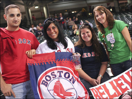 After an 11 hour drive from Boston last night, Mike Bonasoro (left), Renee Merchant (center, left), Robin Woodman, Alison Mallet (right) showed their support for their team behind the Red Sox dugout.
