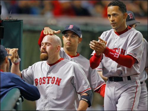 Kevin Youkilis (left) was congratulated by Julio Lugo (right) and his teammates after his solo home run in the first inning.