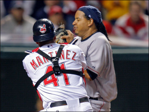 Manny Ramirez was thrown out at home plate after trying to score from second on a single by Mike Lowell (right) in the first inning.